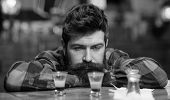 Guy Wasting Time In Bar, Defocused Background. Depressed And Sad Man Sit Alone In Bar Or Pub Near Ba poster