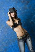 image of pouty lips  - Three quarter view of sexy brunette woman wearing jeans and black bra - JPG