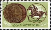 Deportista, montar a caballo y medalla olímpica en sello de correos