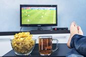 Tv, Television Watching Football Match On Tv With Snacks And Alcohol. Relax In Front Of The Tv. A Fa poster