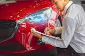 This Career Man Saleman Business Inspection Writing On Notepad Or Book,  Paper With Car Blurry Backg poster