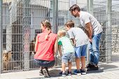 Family looking to adopt a pet from animal shelter watching the poor pet in cage poster
