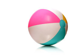 stock photo of beach-ball  - colorful rubber beach ball on white with copy space - JPG