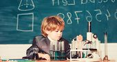 Child Enjoy Studying. Knowledge Concept. Boy Near Microscope And Test Tubes In School Classroom. Kid poster