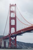 Golden Gate Bridge Covered By Cloud And Fog On Overcast Day, San Francisco, California, Usa. poster