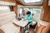 Couples in RV Camper looking at the local map for the trip. Family vacation travel, holiday trip in  poster