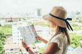 Confused Female With Destination Map Looking For Sightseeing poster