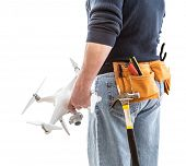 Construction Worker and Drone Pilot With Toolbelt Holding Quadcopter Drone Isolated on White Backrou poster