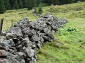 Natural Stone Fence On A Mountain Pasture poster