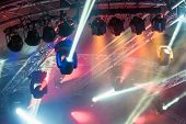 picture of rave  - multiple spotlights on a theatre stage lighting rig - JPG