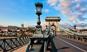 Chain bridge in Budapest, Hungary. View at Royal castle at Buda district over Danube river. Antique  poster