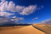 foto of mesquite  - Dark blue skies over the Mesquite Flat Sand Dunes of Death Valley National Park - JPG