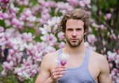 Man Flowers Background Defocused. Botany Nature. Male Beauty. Hipster Enjoy Blossom Aroma. Spring Be poster