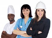Multiracial Group Of Workers On A White Background