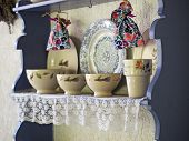 foto of old-fashioned  - Vintage kitchen utensil and dishes on the ledge - JPG