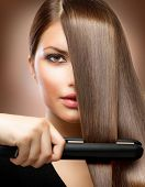 Healthy Hair. Hairstyling. Hairdressing. Hair Straightening Irons.Beautiful Woman with  Long Straigh