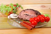 roastbeef on transparent plate and salad bowl