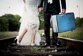 foto of black heel  - Bride and groom are walking outside together