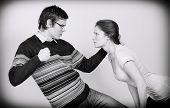 Man Going To Beat His Wife. Home Violence Concept. Black And White