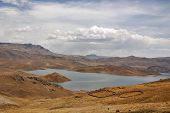 foto of aconcagua  - A desert with mountains lake and clear blue sky in the background in Peru - JPG