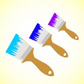 Three Colour Paint Brushes On Yellow Smooth Background