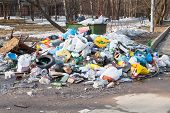 stock photo of dumpster  - many household garbage and urban dumpster  outdoor - JPG