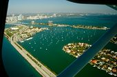 Airplane In Flight Over Miami