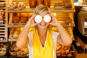 Bakery Shopkeeper Covers Eyes With Meringue