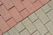 Red and gray paving stones on a walkway