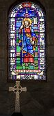 pic of stained glass  - stained glass window of saint patrick with celtic cross in foreground - JPG