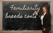 Teacher Showing Familiarity Breeds Contempt  On Blackboard