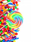 stock photo of lollipops  - Colorful candy corner border with lollipops and gumballs - JPG