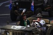 Brisbane, Australia - April 25 : Veteran Waves To Crowd From Jeep  During Anzac Day Commemorations