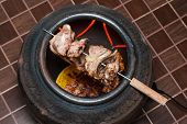 Grilled Pork In Electric Sienna Baked Clay Jar