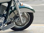 image of amortization  - Motorcycle wheel taken closeup against of road asphalt - JPG