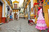 SEVILLE, SPAIN - SEP 11: Shopping street with typical flamenco dress on Sep 11, 2011 in Seville, Spa