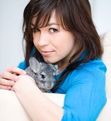 Portrait of a young woman with chinchilla