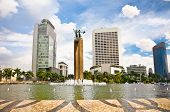 stock photo of tourist-spot  - Selamat Datang Monument and fountain in center of Jakarta - JPG