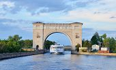 picture of mew  - Sluice Gates in Uglich on the River Volga Russia with cruise boat - JPG