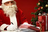 stock photo of letters to santa claus  - Portrait of Santa Claus answering Christmas letters - JPG