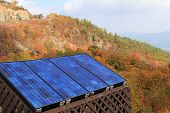 Solar panels on side of colorful mountain