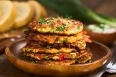 stock photo of red shallot  - Vegetable and egg fritter made of zucchini red bell pepper eggs green onions and thyme 