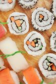 Maki and Nigiri Sushi - California Roll with Avocado and Salmon, Cream Cheese and Raw Salmon inside