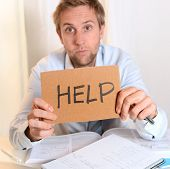 stock photo of overwhelming  - Young Student Stressed and Overwhelmed asking for Help - JPG