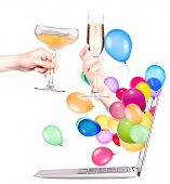 hand with champagne and laptop