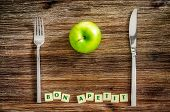 Silverware And Apple On Wooden Table With Bon Apetit Sign