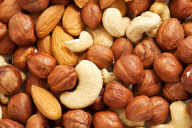 stock photo of brazil nut  - Background from various kinds of nuts almond - JPG