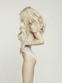 stock photo of posh  - Fashion portrait of young beautiful woman - JPG
