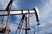 stock photo of oilfield  - silver pumpjack in crude oil field mine - JPG