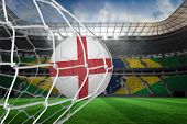 picture of football pitch  - Football in england colours at back of net against large football stadium with brasilian fans - JPG